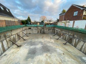 Confined site basement